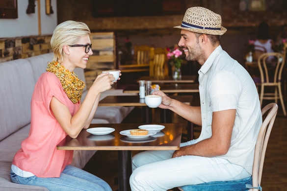 cute-couple-on-a-date-talking-over-a-cup-of-coffee-at-the-cafe