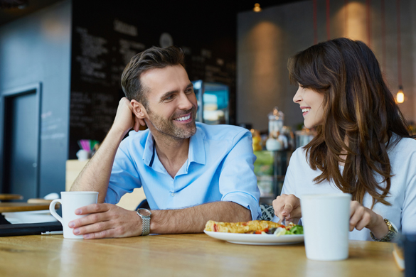 happy-couple-talking-at-cafe