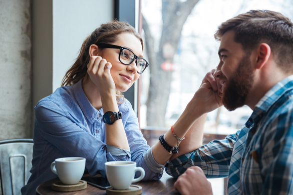 portrait-of-young-beautiful-couple-on-a-date-drinking-coffee-in-cafe