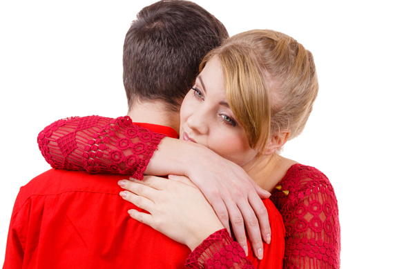 Couple hugging. Woman is sad and being consoled by his partner - Are Aquarius men forgiving