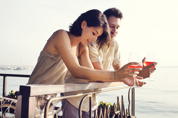 Happy couple drinking outdoor - How Aquarius Men Think When It Comes To Women