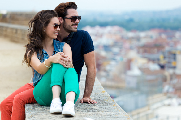 Portrait of young tourist couple looking at the views in the city - How Does The Aquarius Man Act When He Is In Love
