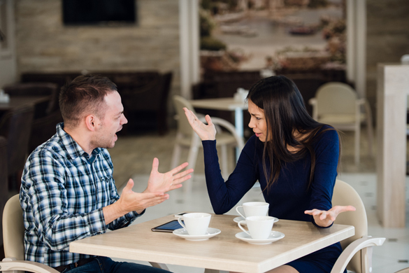 Young couple arguing in a cafe - Do Aquarius Men Ever Get Jealous At All