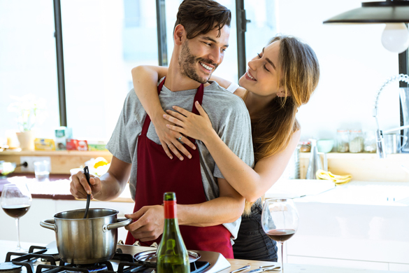 happy young couple cooking together in the kitchen at home - Signs An Aquarius May Be In Love With You