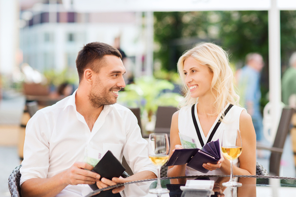 Couple paying in a restaurant